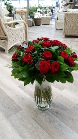 A Dozen Best grade Red Roses with luxurious foliage